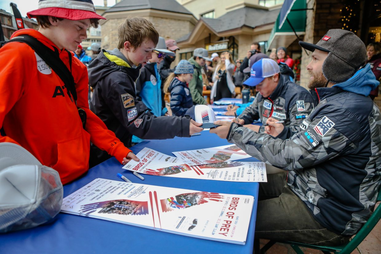 Members of the U.S. Ski Team sign autographs for fans after the Super-G race during the Birds of Prey World Cup on Friday, Dec. 1, in Beaver Creek. The festivities run through Sunday, both on and off the mountain.
