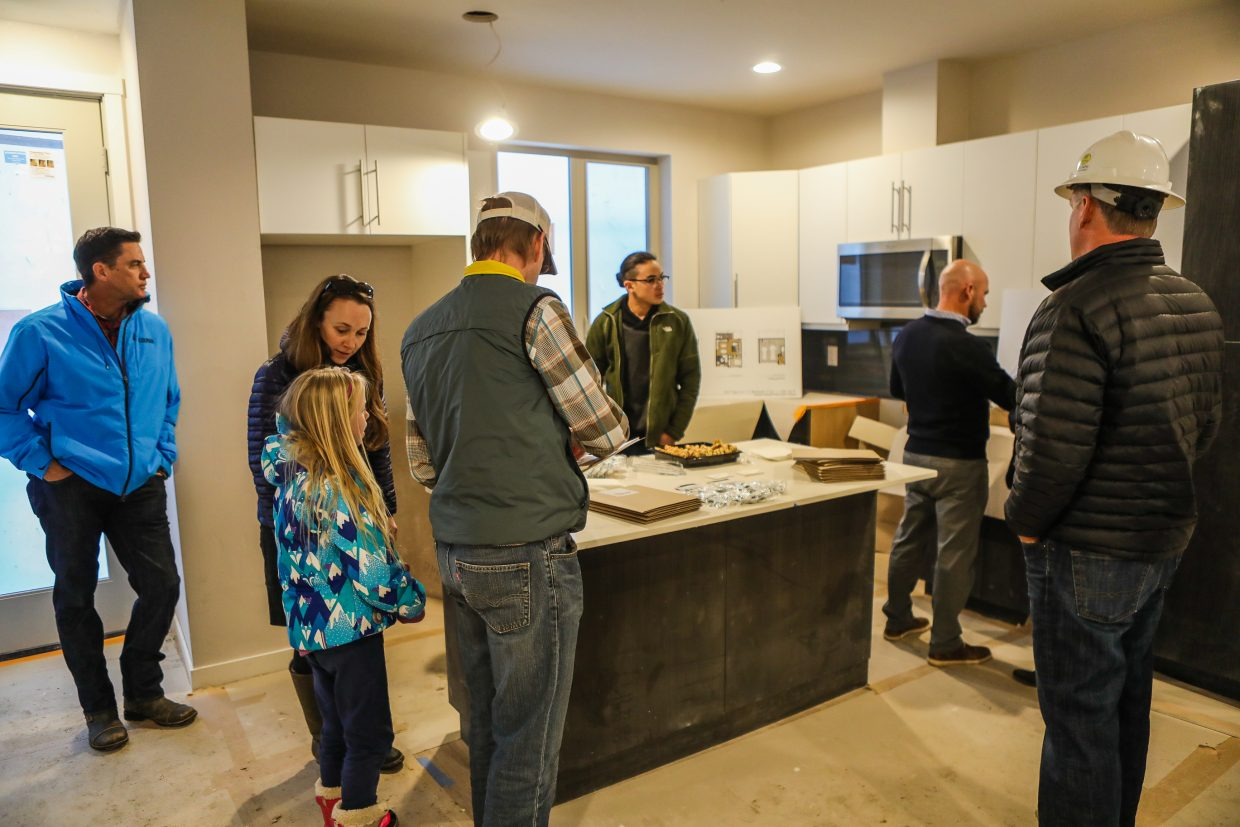 People tour one of the Chamonix Vail's layouts during an open house on Thursday, Dec. 14, in West Vail. Five units are available to purchase, which have a lot of interest in them by people.
