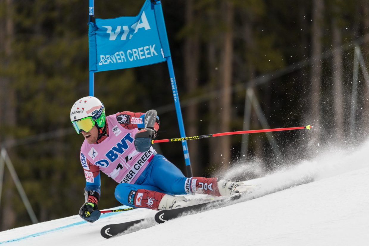 Ted Ligety, of the United States,  charges into the Harrier section of the Birds of Prey World Cup Giant Slalom course during his first run Sunday in Beaver Creek.