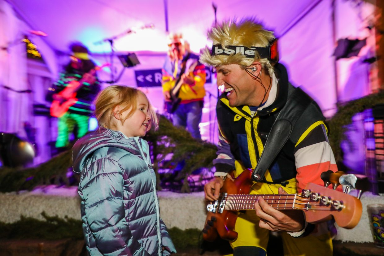Joel Dekanich of the band Rewind jams with Aria Rygg, 4, of Eau Claire, Wis., during the Everbank America's Winter Opening for Birds of Prey Thursday, Nov. 30, in Beaver Creek. Races run through Sunday.