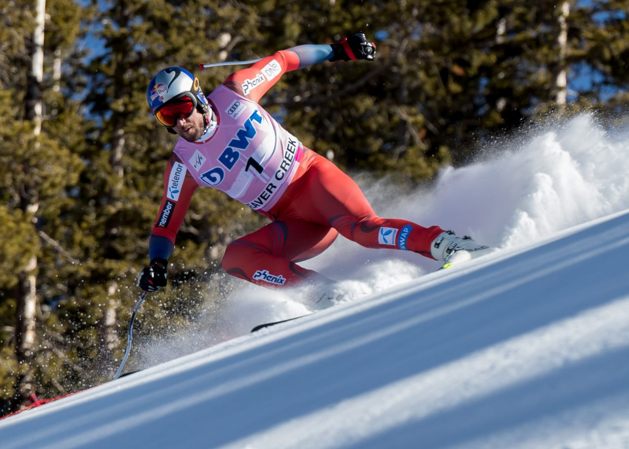 RaceSvindal -VDN-120417 Dominique Taylor/Dominique Taylor Photography Norwary's Aksel Lund Svindal steadies himself as he charges down the Brink at the top of the Birds of Prey Downhill race Saturday at Beaver Creek. Svindal took first place in the race.