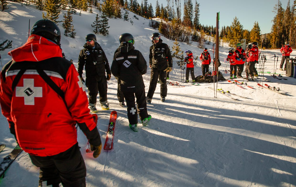 Vail Ski Patrol hang around before tabogan training with the rookies, who wear black before earning the ski patrol cross, on Tuesday, Dec. 5, in Vail. Ski patrol is working with other departments to try and get more terrain open as possible. Beaver Creek is opening Cinch Express Lift Wednesday, Dec. 6, making it the most veritcal open in the state.
