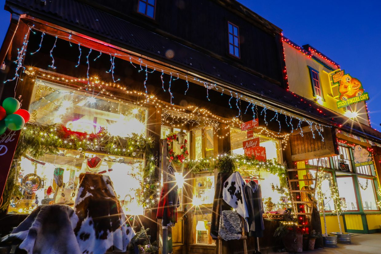 Lights twinkle in store fronts on Sunday, Dec. 10, in Minturn. The Vail Valley is starting to look like the holidays, despite the lack of snow.