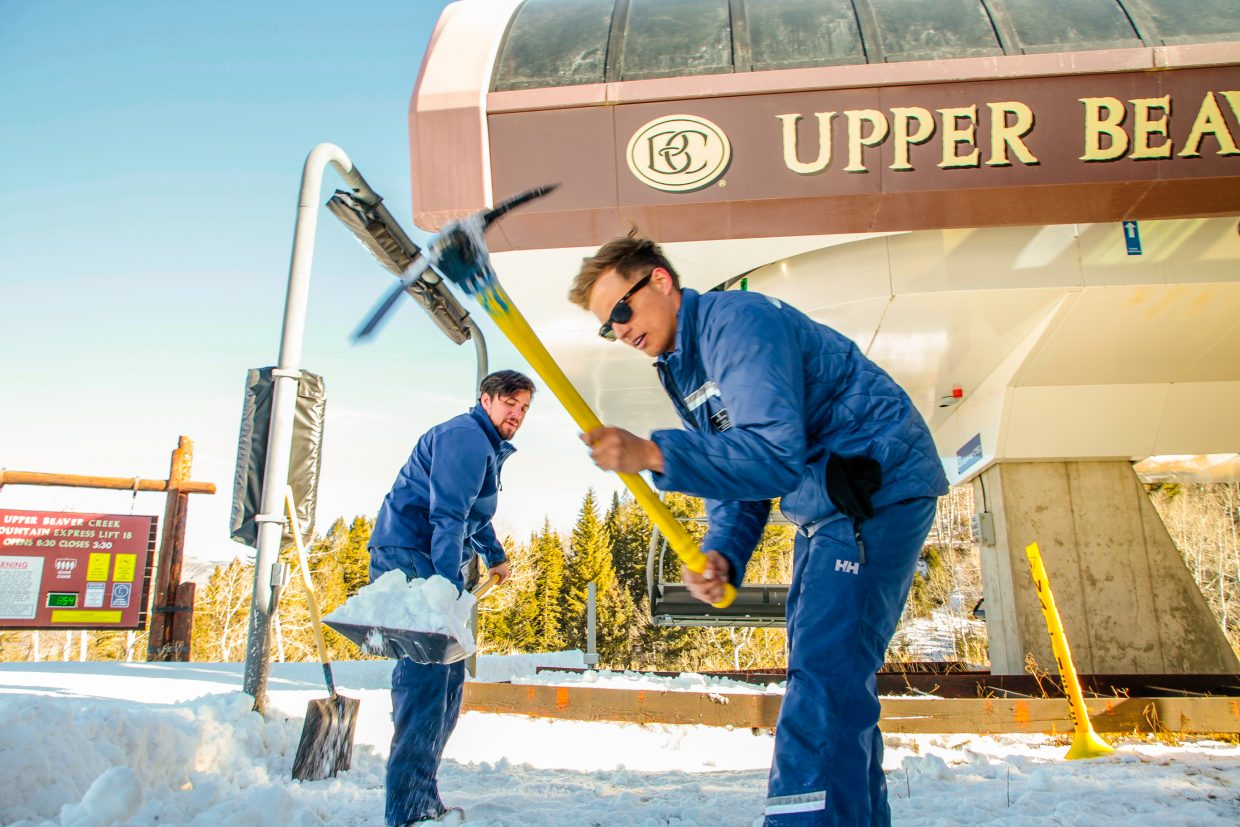 Oliver Padgett, front, and Rob Messic prepare the Upper Beaver Creek Express lift on Monday, Dec. 11, in Bachelor Gulch in Beaver Creek. Despite a lack of snow, cold temperatures are allowing mountain operations to open terrain as possible.