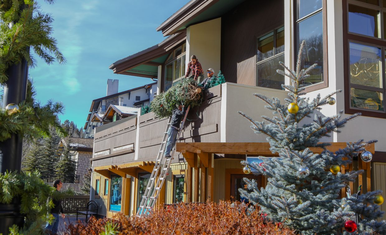 A Christmas Tree is hoisted onto a balcony as decorations go up around the village on Tuesday, Dec. 12, in Vail. Holiday events take place throughout the weekend in Vail, including a sweater run and the annual tree light and lantern walk, Sunday, Dec. 17.
