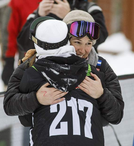 Spencer O'Brien of Canada, with purple googles, hugs Enni Rukajarvi of Finland following their last run in the slopestyle finals during the Dew Tour event Saturday, Dec. 16, at Breckenridge Ski Resort.