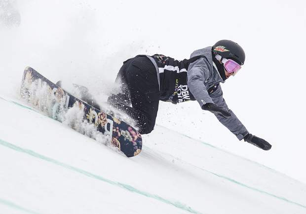 Julia Marino of United States takes a fall in the slopestyle finals during the Dew Tour event Saturday, Dec. 16, at Breckenridge Ski Resort.