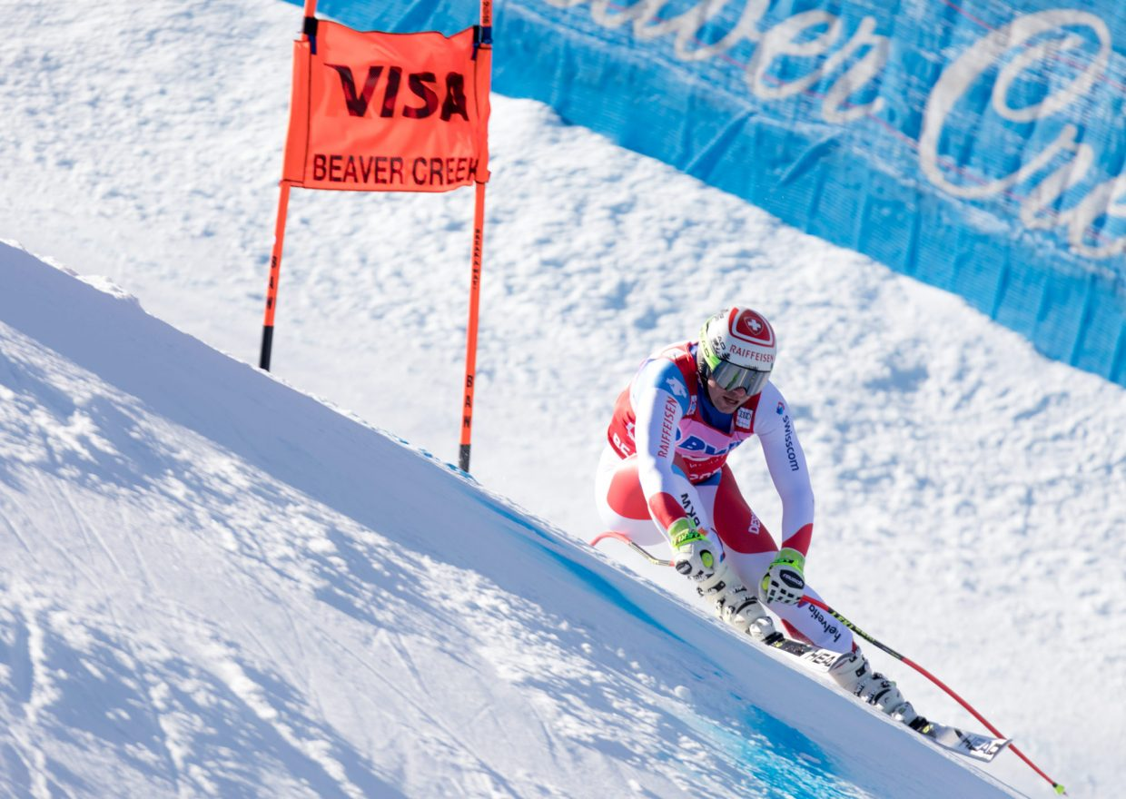 Beat Fuez, of Switzerland, leans hard into a cross falline section of the Birds of Prey Downhill race Saturday in Beaver Creek. Fuez placed second with a time of 1:40.61.