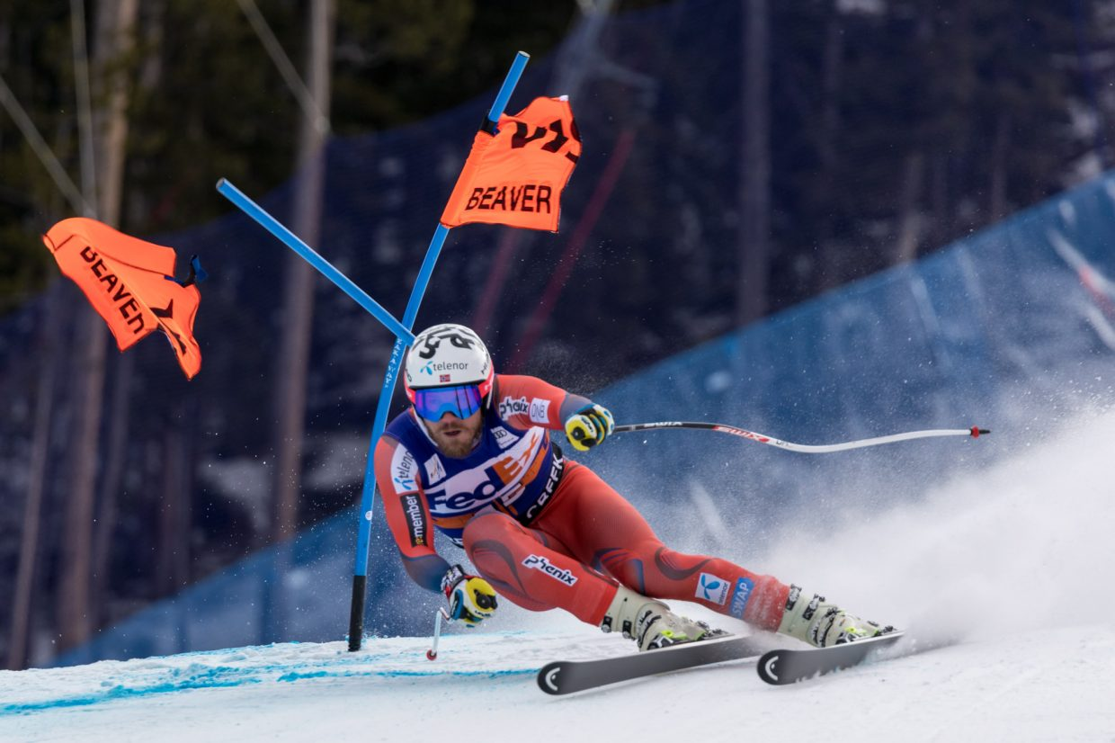 Kjetil Jansrud, of Norway, blasts through a gate at the Harrier section of the Birds of Prey Super G Friday in Beaver Creek.