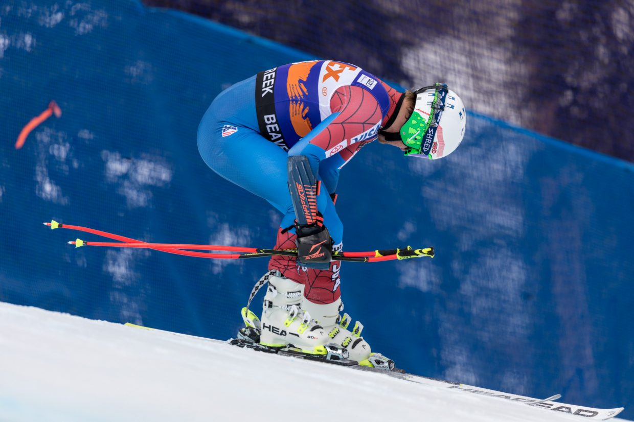 Ted Ligety, of the United States, loosens his boots after skiing of the course and DNFing during the Birds of Prey Super G Friday in Beaver Creek.