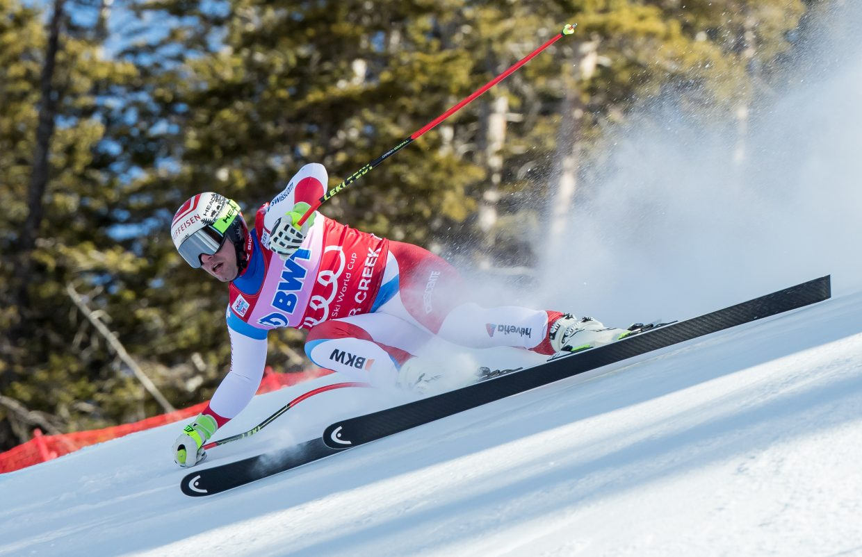 RaceFeuz -VDN-120417 Dominique Taylor/Dominique Taylor Photography Beat Feuz of Switzeland gets low into the turna s he flies down the Brink during the Birds of Prey Downhill race Saturday at Beaver Creek. Feuz finished the race in second place behind Norways' Aksel Lund Svindal.