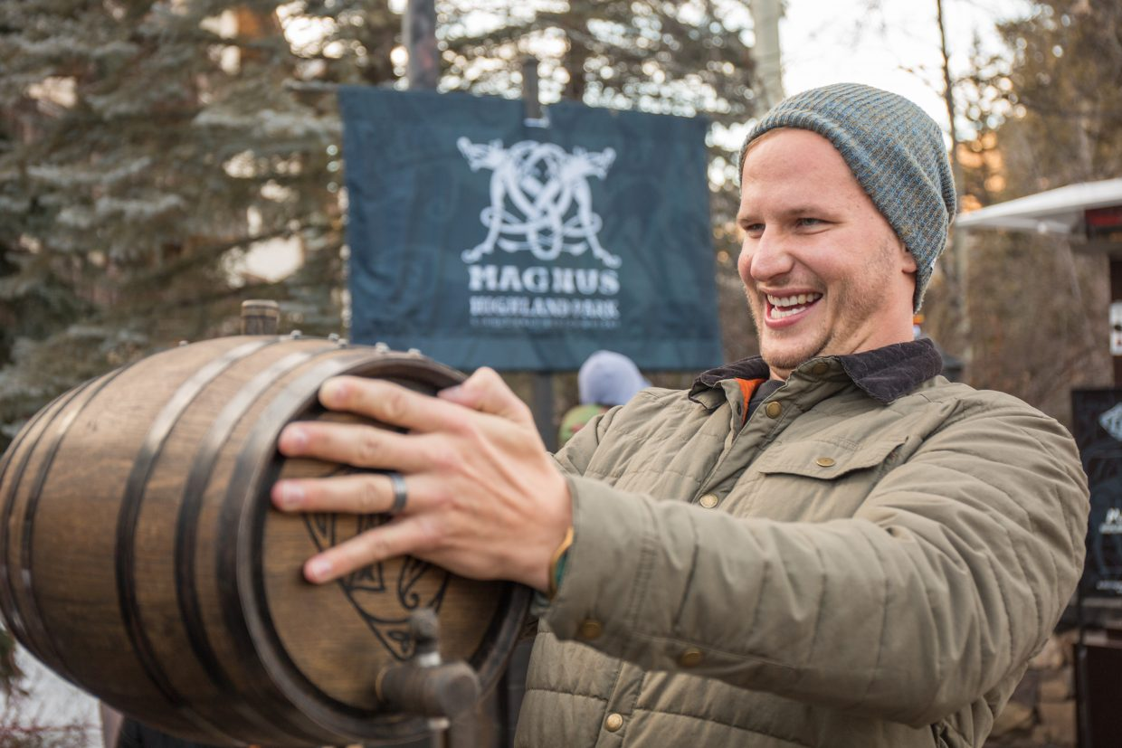 Chad Swift from Denver tries to beat the world record for the cask raise of three minutes, 40 seconds at the Highland Park Magnus Whiskey tasting Friday, at Vail Snowdays.