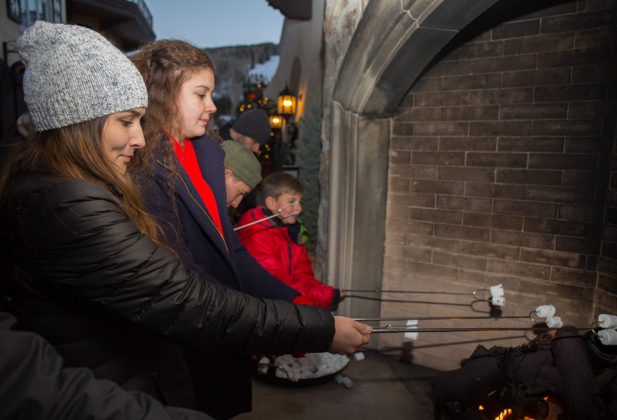 A crowd gathers around the fireplace to roast marshmellows and to eat  Smores in Lionshead for Vail's Snowdays, Saturday.