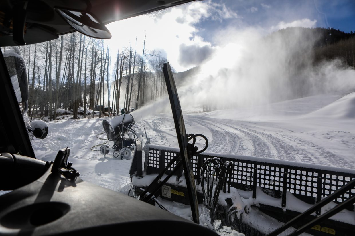 Snow guns crank out snow near Beano's Cabin as a snow cat makes its way to Beano's on Wednesday, Dec. 6, in Beaver Creek. Beano's opens for dinner service Friday, Dec. 8.