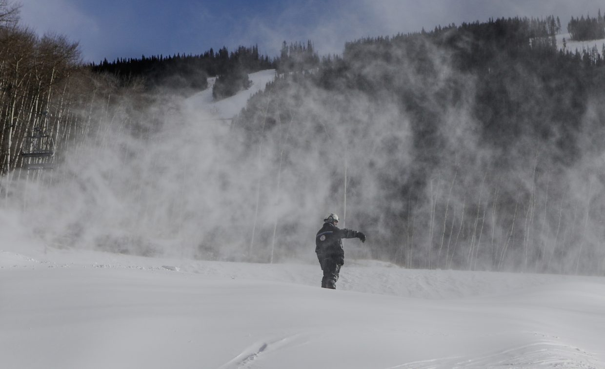 A snowmaker works near Talons Restaurant on Wednesday, Dec. 6, in Beaver Creek.