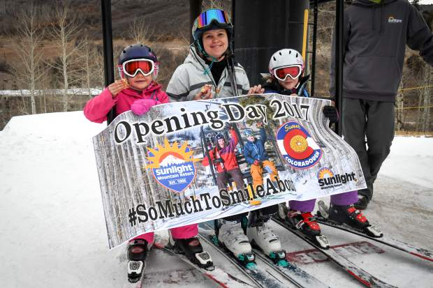Sedona Ditlow, 7, Ashly, and Bristol Ditlow, 9, were the honorary first skiers on the lifts during the opening day at Sunlight Mountain on Thursday.