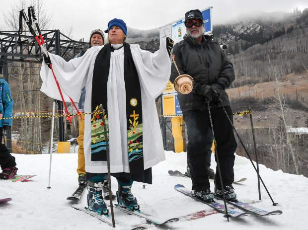 The Rev. Wendy Huber delivers a blessing and gives thanks for the recent snow before the opening of the Tercero lift at Sunlight Mountain on Thursday.