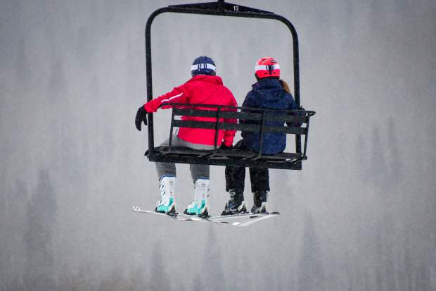 A couple of skiers head up on the lift during the opening day at Sunlight Mountain on Thursday, Dec. 21, 2017 in Glenwood Springs, Colo. (CHELSEA SELF / GLENWOOD SPRINGS POST INDEPENDENT via AP)