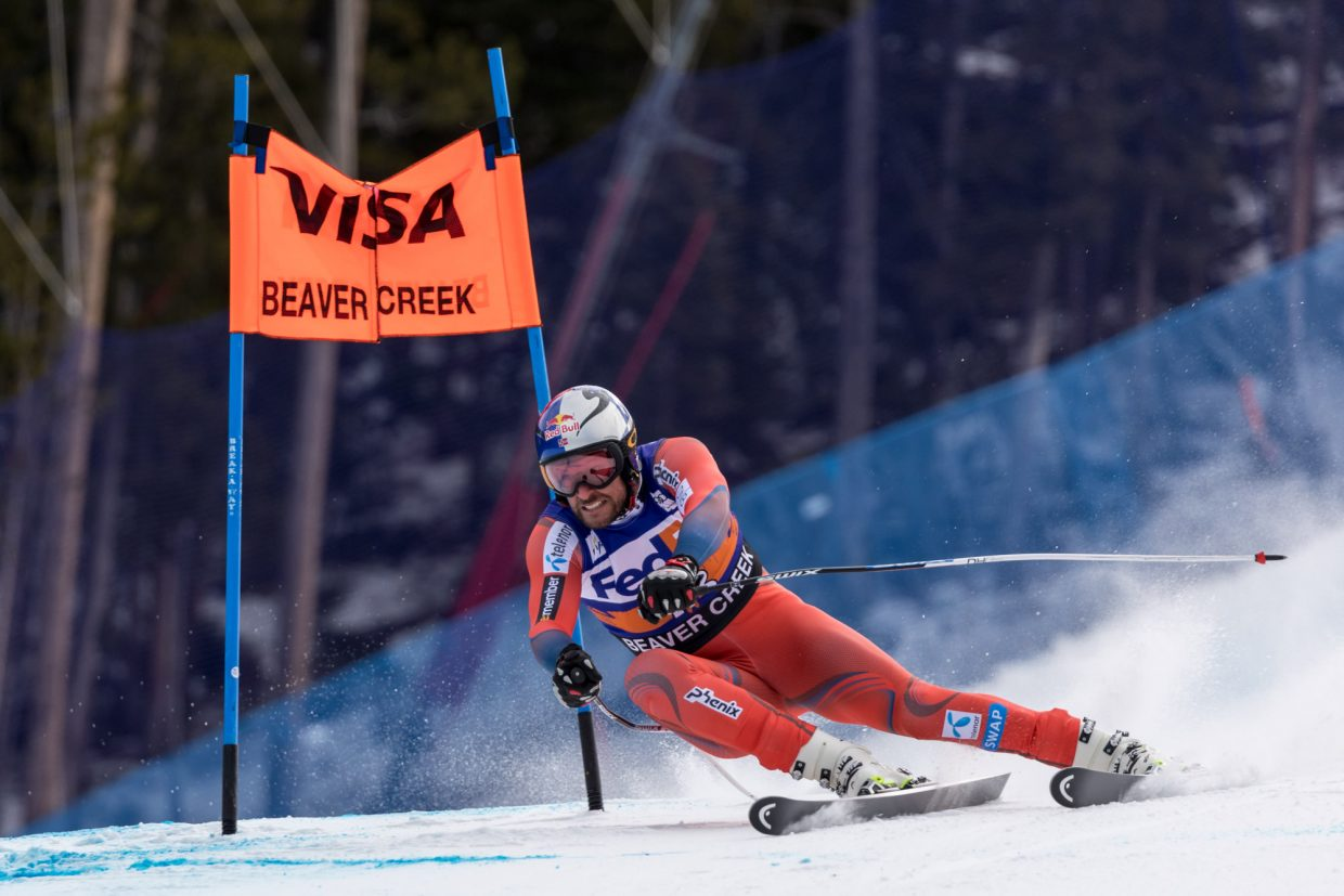 Aksel Lund Svindal, of Norway, gives it all at the Harrier section of the Birds of Prey Super G Friday in Beaver Creek.