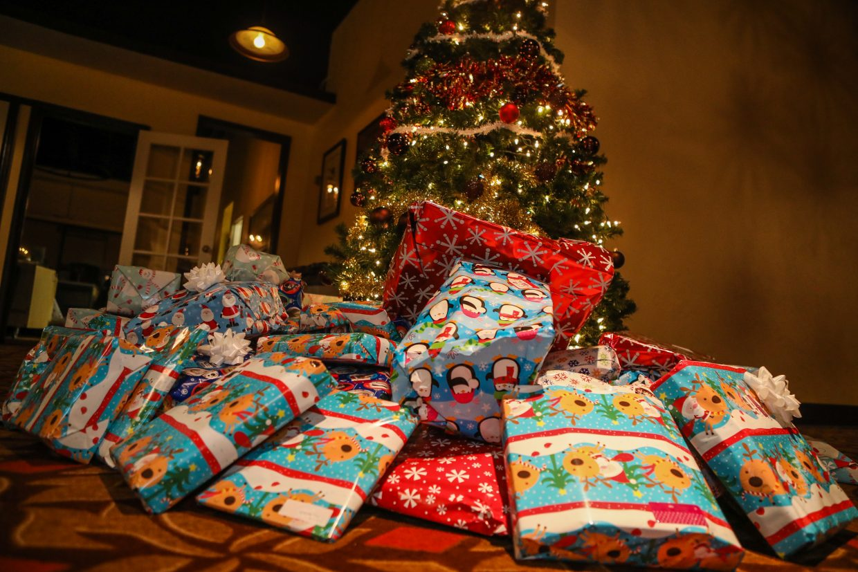 Gifts for kids in the Buddy Mentor Program sit under the tree before being unwrapped by the kids during the Bright Future Foundation party on Tuesday, Dec. 19, in Vail. The gifts were hand-wrapped by therapists at Howard Head.