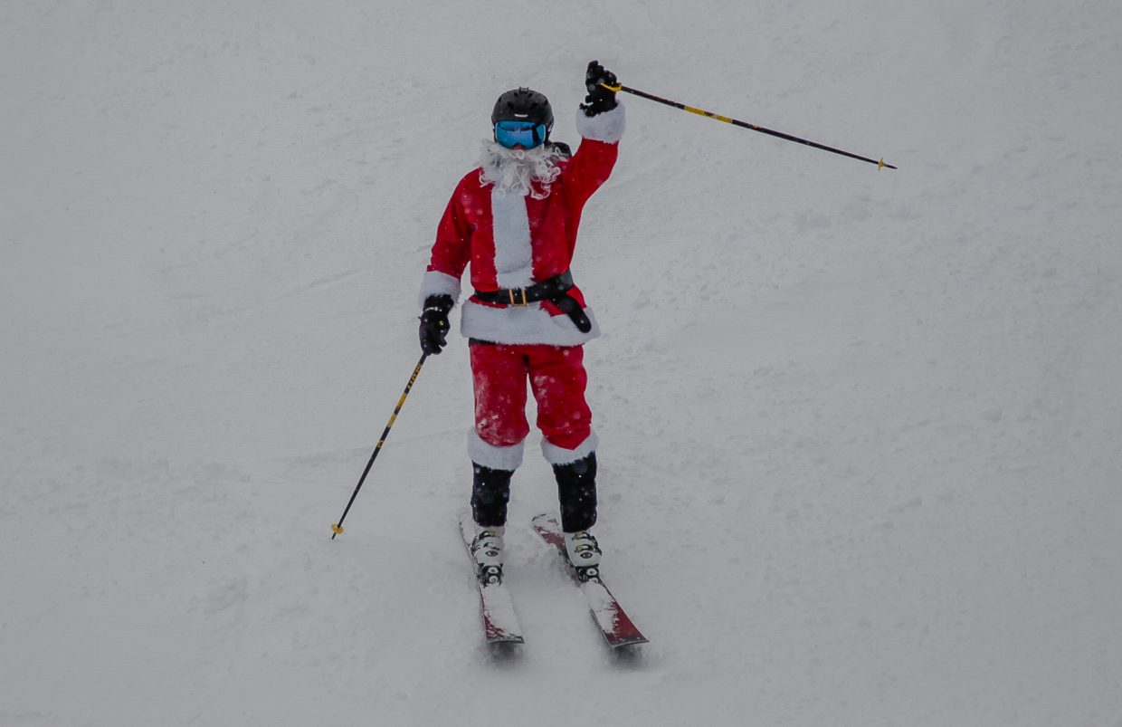 Santa Claus waves to the people on Christmas Day on Monday, Dec. 25, in Beaver Creek. New snow greated holiday skiers.