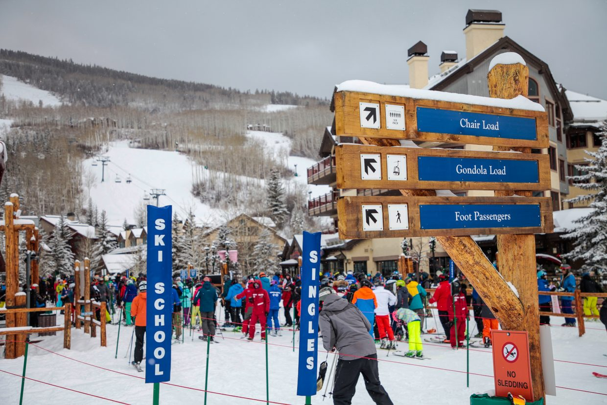 Skiers and snowboarders wait in line at the base of Beaver Creek on Monday, Dec. 25, in Beaver Creek.