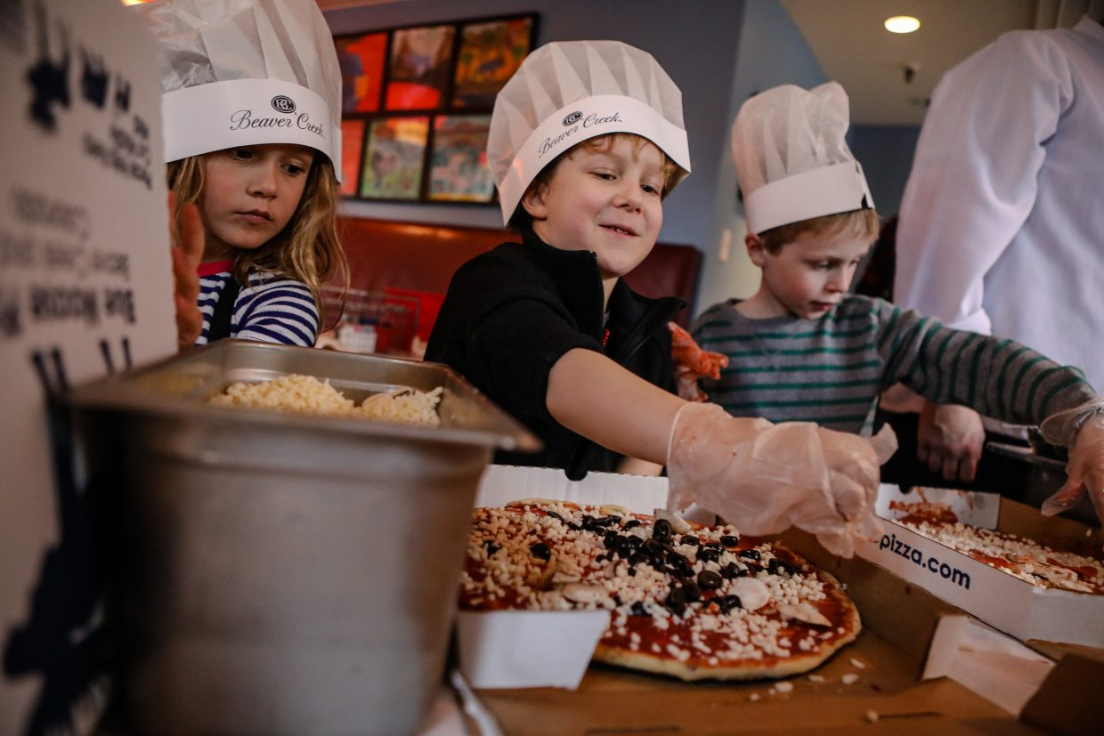 Channing DeFracnesco of New Jersey makes a pizza during the Beaver Creek Culinary Weekend on Satrurday, Jan. 20, in Beaver Creek. Kids were able to create their own pizzas.