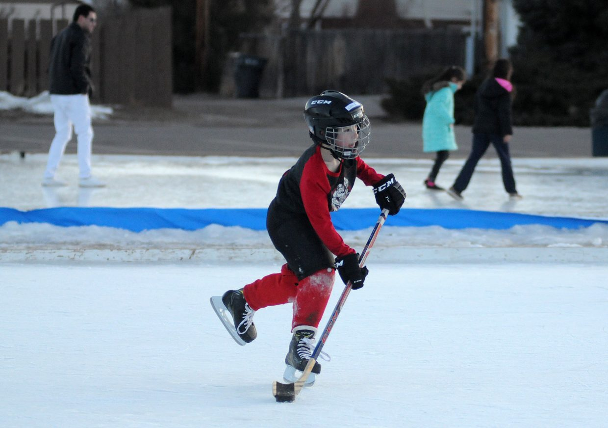 Eagle Ice Rink 3 KA 1-17-18 Kristin Anderson Calvin Swanson, 8, gets in some skating time Wednesday at the Eagle Town Park Ice Rink.
