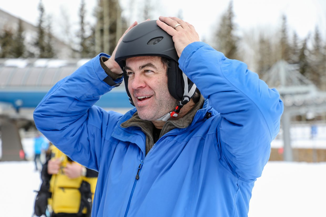 Alex Michel of Vriginia tries on a helmet at the safety booth at the Base of Gondola One on Saturday, Jan. 13, in Vail. Michel said he thought it was time to get a helmet when he took a fall the other day. People were asked to give donations for the helmets.