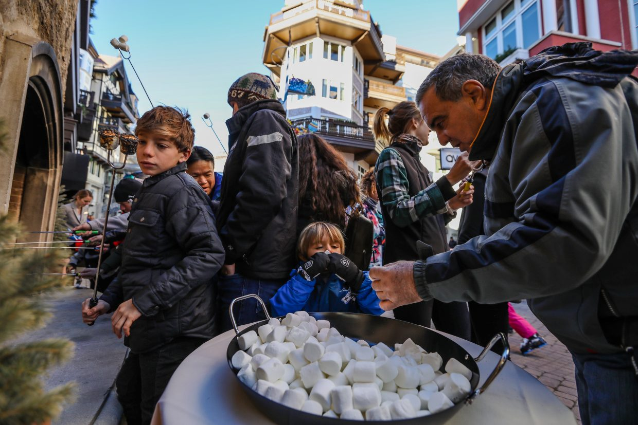 Kids and adults enjoy free s'mores over an open fire in the Arrabelle on Thursday, Dec. 28, in Lionshead in Vail. The Arrabelle is celebrating its 10th anniversary with s'mores and more on Friday, Dec. 29, in Lionshead.
