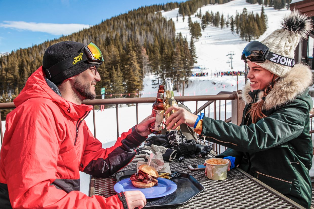Lucia Cornejo and Luis Gonzalez Lanuza of Argentina cheers a cold beer at Sarge's Grill at Mid Vail on Saturday, Dec. 30, in Vail. Beer is a staple of Apres ski and on-mountain enjoyment..