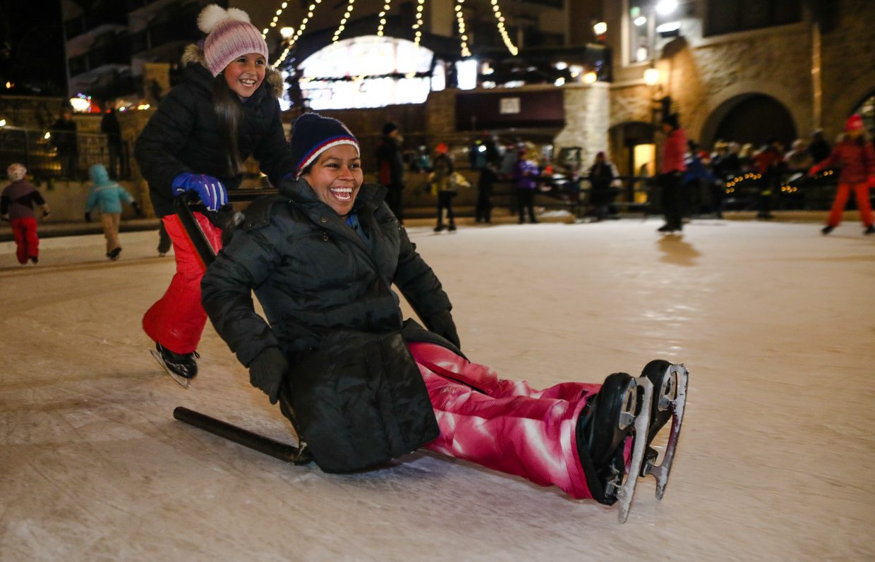 Brizzia Correl, 9, pushes her mentor Norma Gurrola during the skate and gift night with the Buddy Mentor Program on Tuesday, Dec. 19, in Lionshead in Vail. Howard Head Sports Medicine partners with EpicPromise and Bright Future Foundation to give kids around the Vail Valley to brighten up the holidays. The two have known each other for more than five years.
