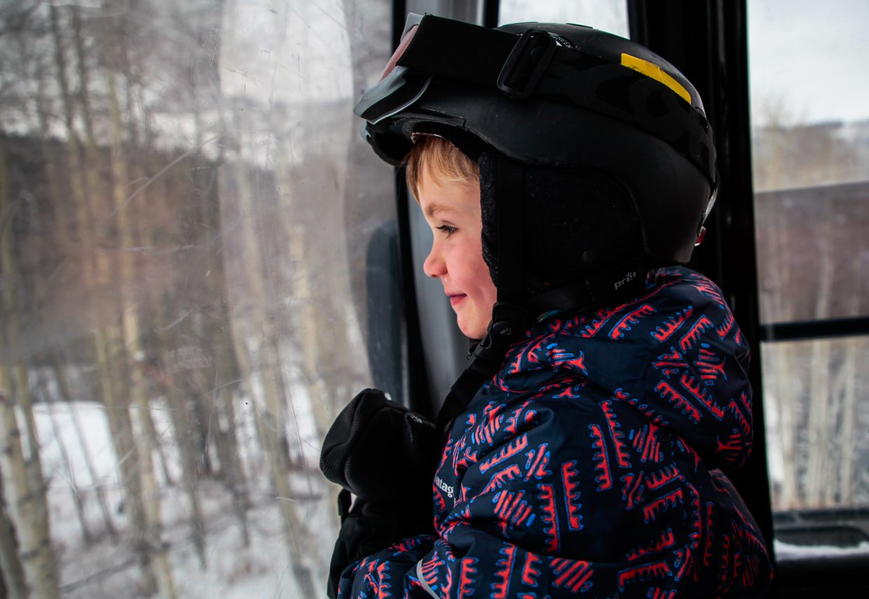 Brennan Berdoulay, 4, of Eagle-Vail admires the new snow out of the gondola on Christmas Day on Monday, Dec. 25, in Beaver Creek. The Vail Valley picked up new snow in the last few days, just in time for the holiday crowds. More terrain will continue to open on Vail and Beaver Creek.
