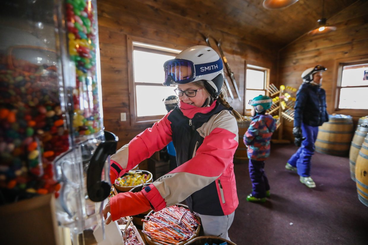 Allison Kasztejna of New Hampshire fills her bag with candy at Candy Cabin on Tuesday, Jan. 9, in Beaver Creek. The Candy Cabin is located at the top of Strawberry Park Express Lift in the building with Ski Patrol. The cabin features candy by the pound, as well as other goodies.