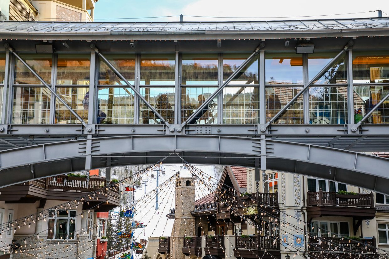 People hang out in the skyway above the ice rink watching the activity below in Lionshead Village on Monday, Dec. 18, in Vail. Snow is possible by the end of the week.