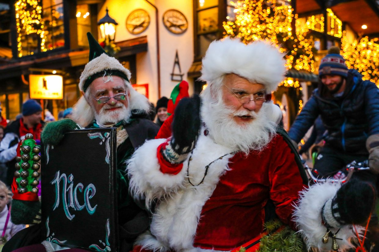 Santa Claus hops on a pedicab during the 11th annual Lantern Walk and Vail Winterfest Ice Theater on Friday, Dec. 22, in Vail Village. The event brings light to the darkest time of year, the Winter Solstice.