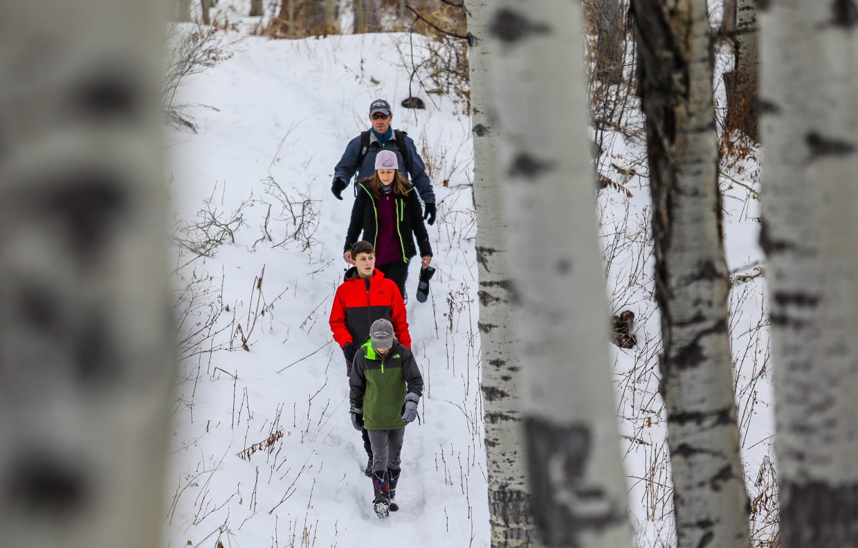 The Lucia family, of Massechu hikes East Lake Creek Trail in the White River National Forest on Wednesday, Dec. 27, in Edwards. The dad, Chris, said he comes out and hikes the trails, including the hut system, and thought it would always be fun to show his family the trail system around the area.