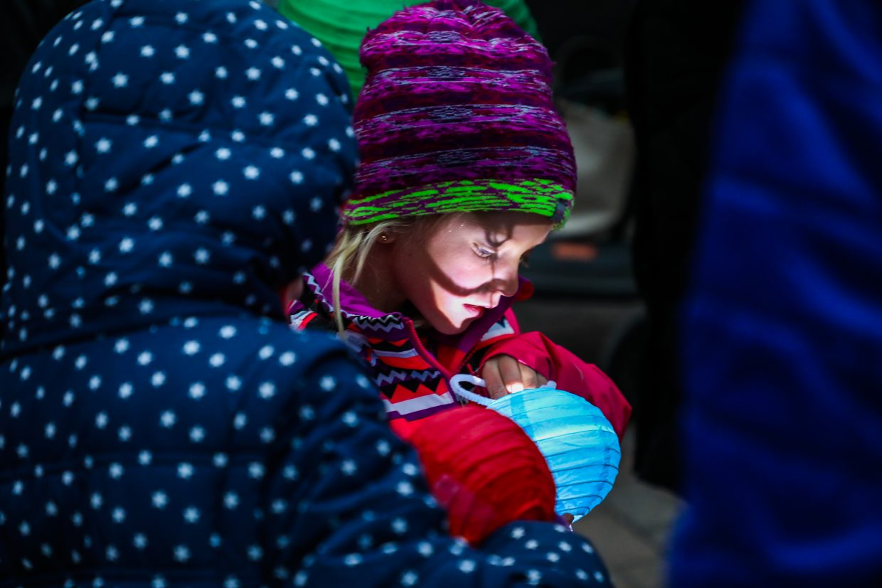 Avery Klingelheber of Carbondale checks the light on her lantern during the 11th annual Holiday Lantern Walk on Friday, Dec. 22, in Vail. Hundreds of lanterns lit the walk from the covered bridge to the Ice Theater on Gore Creek.