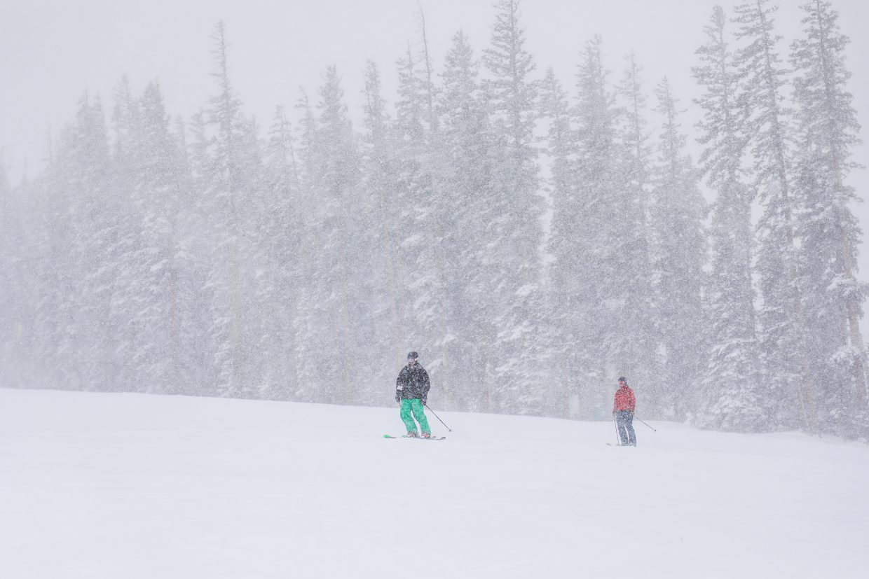 Skiers make their way down from the top of Cinch Express Lift as the snow falls on Friday, Jan. 12, in Beaver Creek.