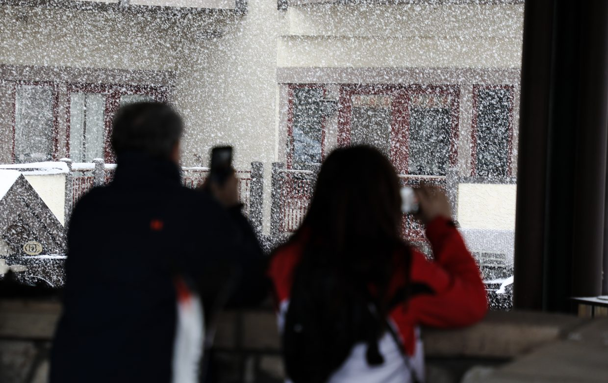 People admire and document the snow falling on Friday, Jan. 12, in Beaver Creek. Heavy snow fell throughout the day, adding more than half a foot during the day.