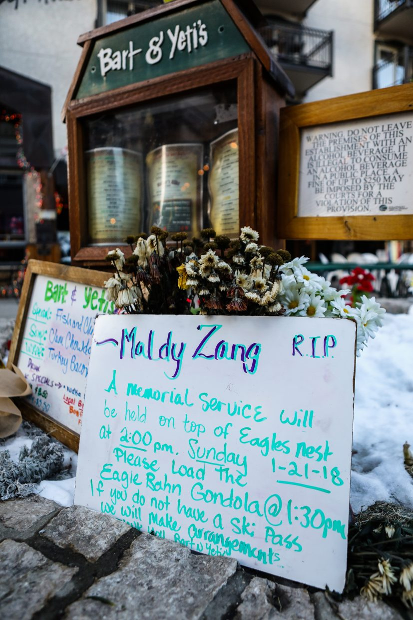 Ski boots, flowers and a sign informing people on a memorial service for George sit in front of his place of employment, Bart & Yetis, on Friday, Jan. 19, in Vail. The memorial service will be held 1:30 p.m. Sunday, Jan. 21, at the top of Lionshead.