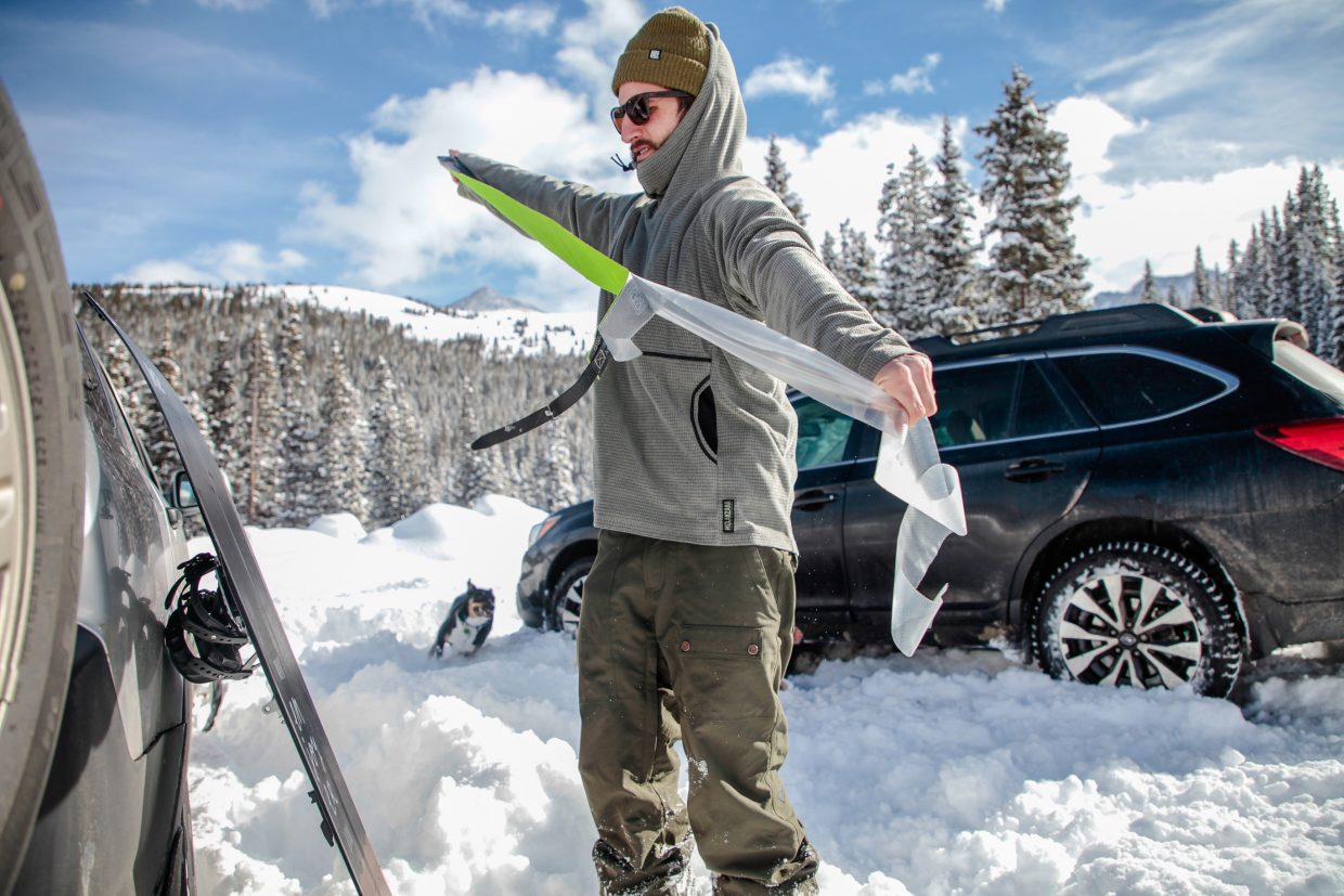 Marty Tarantino, of Avon, puts his skins on his splitboard before setting off on Mayflower Gulch Trailhead on Tuesday, Dec. 26, in Summit County. Mayflower Gulch is south of Copper Mountain on Fremont Pass on Colorado State Highway 91.