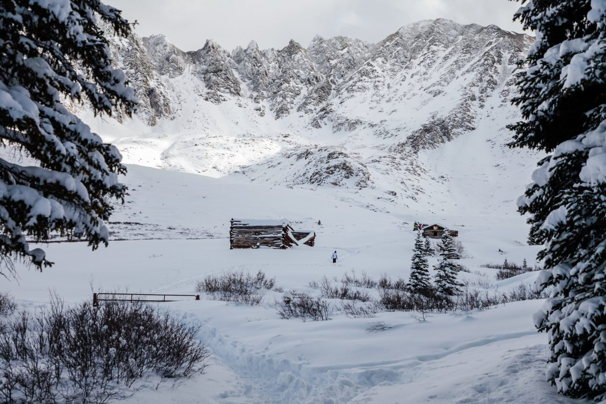 Snowshoers and ski tourers explore the old mining ruins in Mayflower Gulch on Tuesday, Dec. 26, in Summit County. The new snow brought people out to ski and hike the backcountry.