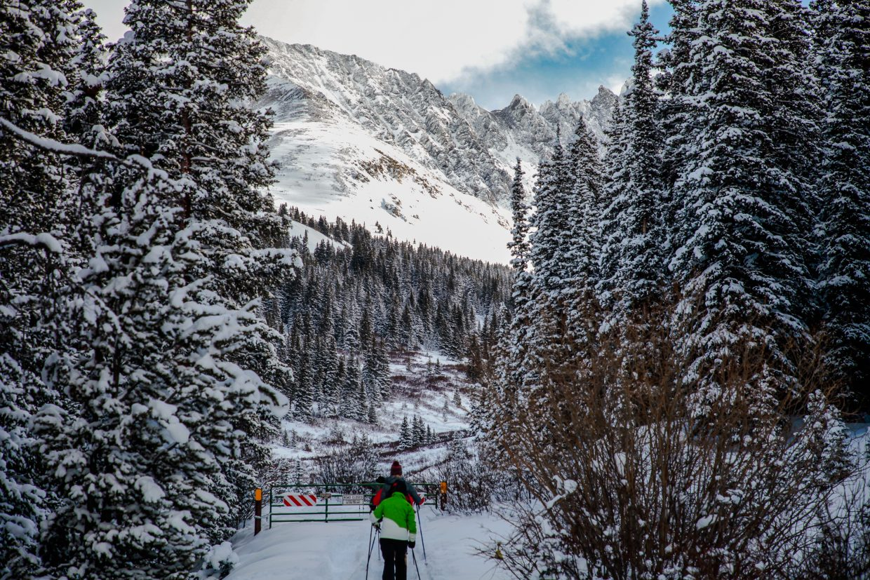 Cross country skiers and snowshoers start at the Mayflower Gulch Trail on Tuesday, Dec. 26, in Summit County. The area saw big totals from the storm. The Vail Valley is still looking for its first big storm with snow totals more than a foot in 24 hours.