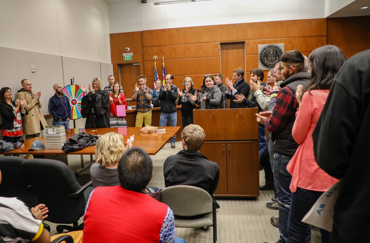 Judge Katherine Sullivan spins the Wheel of fate during her farewell, which is normally used in drug court, on Wednesday, Dec. 20, in Eagle. Sullivan started the program to provide other options to those struggling with addition within the legal system.