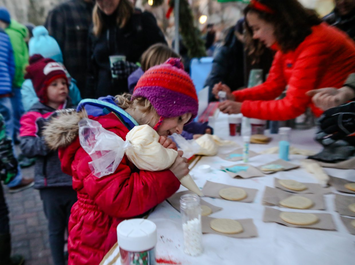 Henley Brown, 6, of Eagle decorates a cookie for the annual Holiday Tree Lighting on Sunday, Dec. 17, in Vail. Hot cocoa, cookies and live music were just a bit of the event fun.