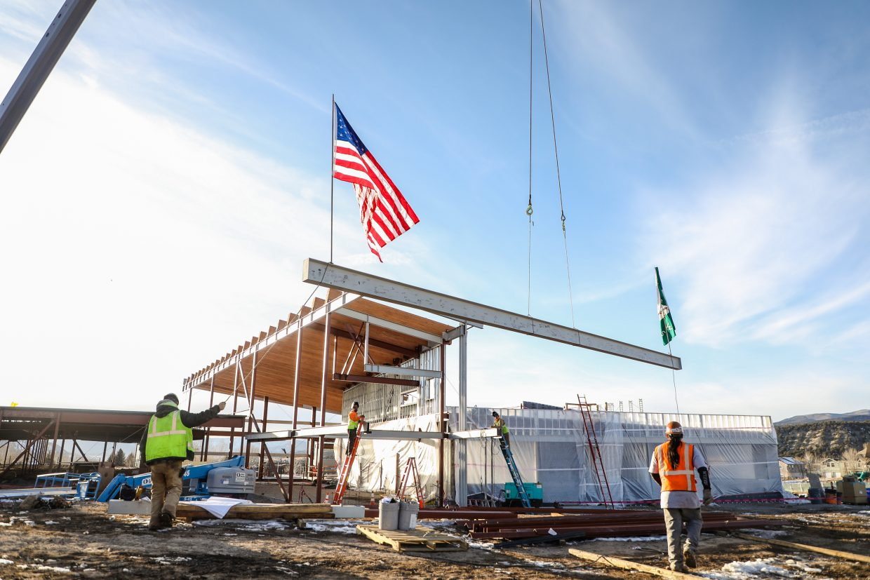 A beam signed by students is raised before being welded on the new Eagle Valley Elementary School on Wednesday, Jan. 24, in Eagle. The beam was signed by students and  Eagle County School Board members, and is the last steel beam to be raised on the school.