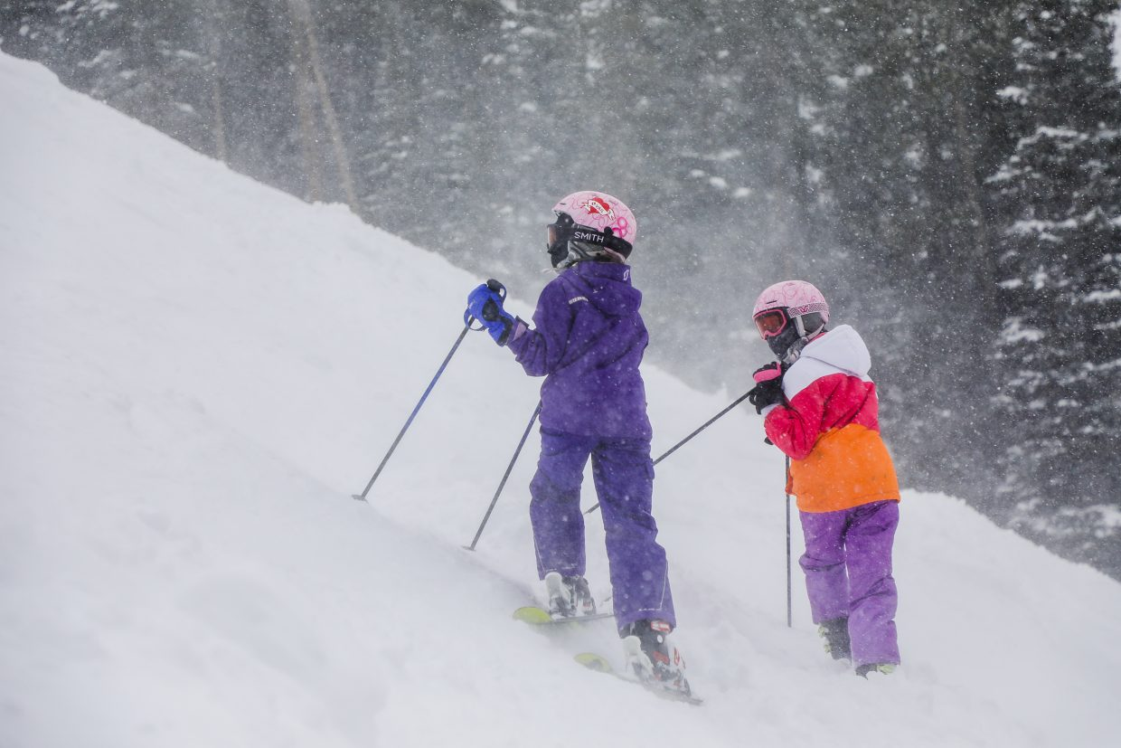 Katrina and Milena Perisic of Serbia watch their dad, Dusan, ski down Goshawk run during a powder day on Thursday, Feb. 15, in Beaver Creek. February has provided fresh powder.