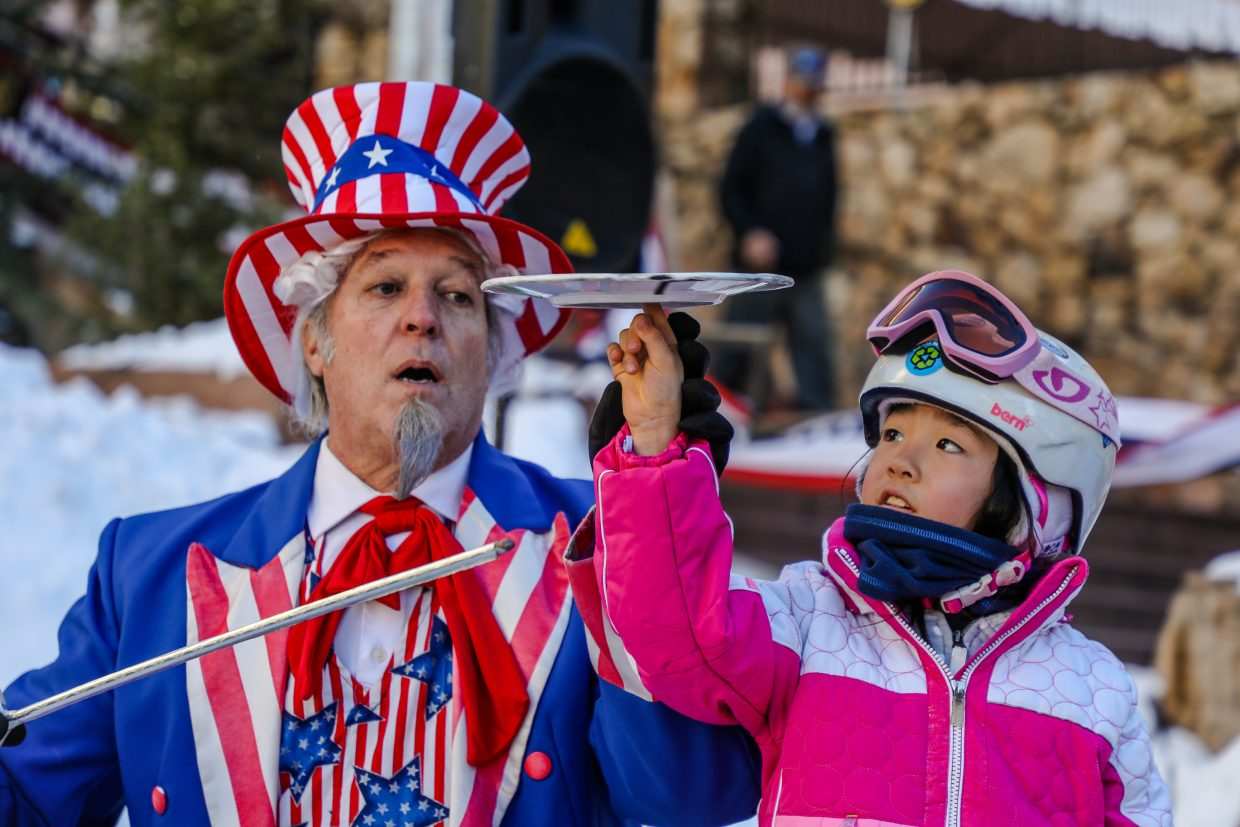 Paul Borillo helps Sophie Lin, 7, spin a plate on her finger during Prez Fest on Saturday, Feb. 17, in Beaver Creek. Prez Fest runs through Monday, Feb. 19, in Beaver Creek.