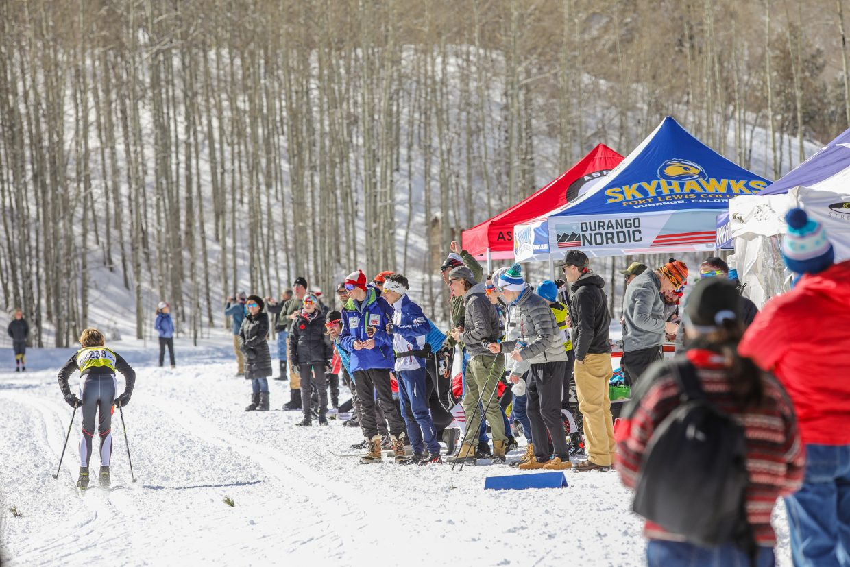 Fans cheer on Owen Grimmer of Ski and Snowboard Club Vail during the NCAA West Regionals hosted by Ski and Snowboard Club Vail and University of Denver on Sunday, Feb. 11, at Maloit Park in Minturn. The event was two days of racing.